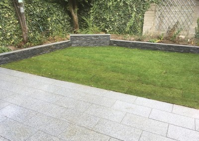 rollout grass limestone walling and silver granite paving