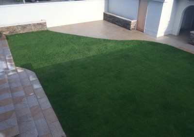 rollout grass quartz walling and yellow granite paving