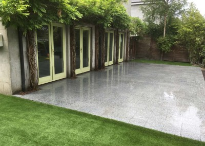 silver granite paving and artificial grass
