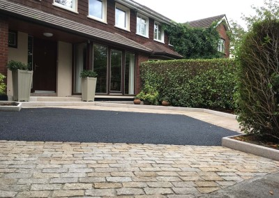 yellow granite paving and tarmac